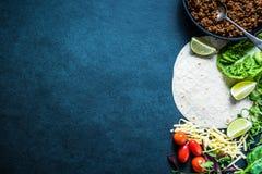 Mexican fajitas or tortillas, food border background recipe. Mexican fajitas or tortillas, food border background with space for text or recipe. Overhead on dark Stock Image