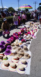 Mexican female woman selling hats in a religious procession Royalty Free Stock Photo
