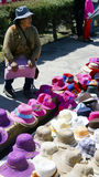 Mexican female woman selling hats Royalty Free Stock Images