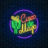 Mexican festival flyer design with cactus and sombrero hat. Glowing neon sinco de mayo holiday sign in circle frame on dark brick wall background. Mexican Stock Images