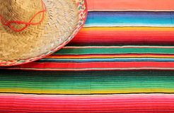 Poncho sombrero background mexican rug blanket fiesta. Poncho sombrero background Mexican fiesta rug in bright colours with copy space traditional poncho Royalty Free Stock Image