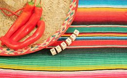 Mexican fiesta poncho rug in bright colors with sombrero Royalty Free Stock Image