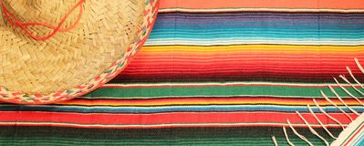 Poncho sombrero background Mexican fiesta rug serape. Poncho sombrero background Traditional Mexican fiesta rug in bright colours with copy space serape royalty free stock photo