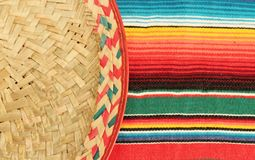 Poncho sombrero Mexican fiesta backgrund. Poncho, sombrero, background, mexico, mexican, copy space, Traditional Mexican fiesta poncho rug in bright colors with