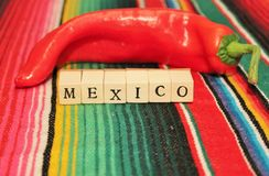 Mexican fiesta poncho rug in bright colors with so Stock Photos