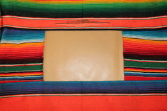 Mexican fiesta poncho rug in bright colors Stock Photos