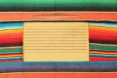 Mexican fiesta poncho rug in bright colors stock, photo, photograph, image, picture. Traditional Mexican fiesta poncho rug blanket in bright colours background stock photo