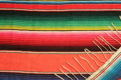 Poncho background Mexican fiesta rug in bright colors. Poncho background Mexican fiesta poncho rug  in bright colors with copy space. Día de Muertos Royalty Free Stock Photography