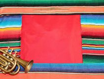 Mexican fiesta poncho rug frame trumpet Stock Photo