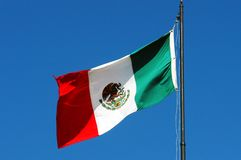 Mexican flag. Mexican national flag waving on blue sky Stock Image