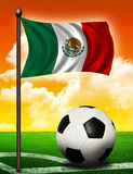 Mexican flag and ball. On soccer field Stock Photo