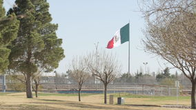 Mexican Flag Blowing in the Wind Near the Border 2 stock video footage
