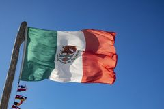 Mexican flag. In the blue sky royalty free stock image