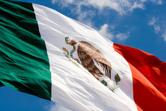 Mexican flag in blue sky. Green, white and red Mexican flag waving stock photos