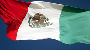 Country Flag of Mexico. The Mexican flag flying against a blue sky Royalty Free Stock Image