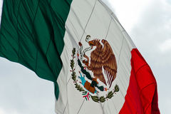 Mexican Flag. Horizontal shot of the mexican flag being moved by the wind on a overcast day Royalty Free Stock Image