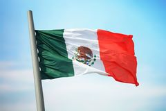 Mexican flag. Flag of Mexico against the background of the sky stock photography