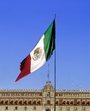 Mexican Flag and National Palace. Building at the zocalo of Mexico City stock image