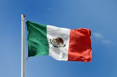 Mexican flag against blue sky royalty free stock photos