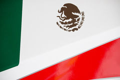 Mexican Flag on Race Car. The colors and crest of the national flag of Mexico painted on the body work of a race car royalty free stock photos