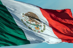 Mexican flag red white and green. Mexican flag weaving on sky background royalty free stock photos
