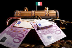 Mexican flag on top of crate. Full of money Royalty Free Stock Images