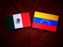 Mexican. Flag with Venezuelan flag on a tree stump stock image