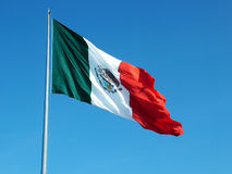 Mexican flag waving in wind. Mexican flag flying in wind on clear day royalty free stock photos