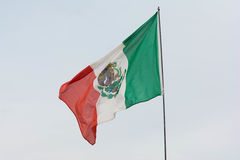 Mexican flag weaving on sky background. Irwindale, USA - March 4, 2017: Mexican flag weaving on sky background on display during 742 Race Wars at the Irwindale royalty free stock photography