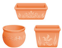 Mexican Flowerpots. Embossed floral designs on round, rectangular, and square clay flowerpots with sculptured floral designs. EPS8 organized in groups for easy Royalty Free Stock Images