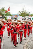 Mexican flute band parade. AABENRAA, DENMARK - JULY 6 - 2014: Mexican flute orchestra is marching down the street at the annual tilting festival in Aabenraa Royalty Free Stock Images