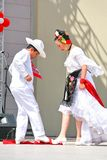 Mexican folk dance. ISTANBUL - APRIL 23: Unidentified 12 years old Mexican children in traditional costume perform folk dance during National Sovereignty and Stock Photos