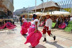 Mexican folklore dancers are dancing with passion in front of the Mexico pavilion at EXPO Milano 2015. stock photo