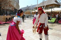 Mexican folklore dancers are dancing with passion in front of the Mexico pavilion at EXPO Milano 2015. royalty free stock photography