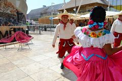 Mexican folklore dancers are dancing with passion in front of the Mexico pavilion at EXPO Milano 2015. royalty free stock photo