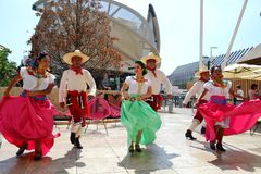 Mexican folklore dancers are dancing with passion in front of the Mexico pavilion at EXPO Milano 2015. stock images