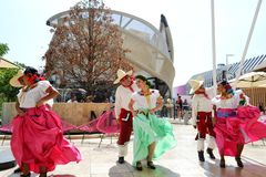 Mexican folklore dancers are dancing passionately in front of the Mexico pavilion at EXPO Milano 2015. royalty free stock photo