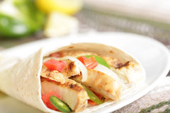 Mexican food. Tasty Mexican fajitas burrito with grilled pork or chicken (white meat Royalty Free Stock Photo
