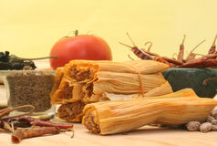 Mexican Food. Tamales With Red Peppers and Pinto Beans on Yellow Background Stock Image