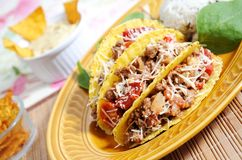 Mexican food. Tacos filled with minced meat peppers and chees - guacamole sauce on background Royalty Free Stock Image