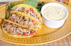 Mexican food. Tacos filled with minced meat peppers and cheese  - sauguacamole ce on side Stock Images