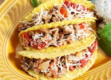Mexican food. Tacos filled with minced meat peppers and cheese  - rice  on side Royalty Free Stock Photo