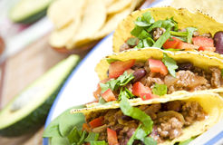 Mexican food. Tacos stuffed with beans meat salad and tomatoes Stock Photo