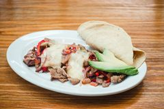 Mexican food, Alambre is made with Beef, onion, bacon, chili, cheese and tortillas in Mexico. Tacos mexicanos royalty free stock photography