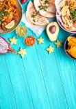 Mexican food background. Traditional Mexican food background. Table with different Mexican dishes. Cheese nachos, tacos, guacamole, fajitas, tortilla chips Royalty Free Stock Photos