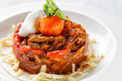 Mexican food - beef fajitas with peppers and pasta on white plate close up.  Royalty Free Stock Images