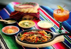 Mexican food 3. A mexican chicken and steak fajitas platter Royalty Free Stock Photo