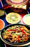 Mexican food 4. A mexican chicken and steak fajitas platter Royalty Free Stock Images