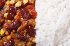 Mexican food is chili con carne and rice macro horizontal Stock Images