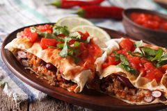 Mexican Food: chimichanga with tomato salsa close-up horizontal royalty free stock photos